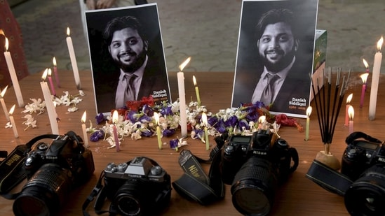 A candlelight tribute to Pulitzer prize winner photojournalist Danish Siddiqui, who was killed in clashes with Taliban in Afghanistan, at the press club in Guwahati, on Sunday.(PTI Photo)