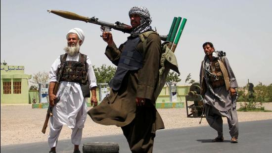 Former Mujahideen hold weapons to support Afghan forces in their fight against the Taliban, on the outskirts of Herat province, Afghanistan July 10, 2021 (REUTERS)