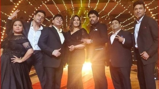 Kapil Sharma poses with the team of The Kapil Sharma Show as they return on sets.