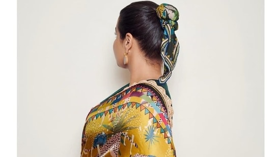 The 42-year old took to her Instagram feed and shared multiple images o herself wearing a printed black and yellow saree printed with elements of nature along with a sleeveless blouse, and a funky scarf tied around her bun to give it a fusion look that combined vintage with modern elements.(Instagram)