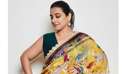 Most recently Vidya Balan decided to treat fans to a stunning series of throwback images of herself in a saree inspired by the elements of nature, her hair secured perfectly at the back with a bright coloured scarf.(Instagram)