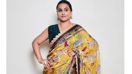 Vidya is seen wearing the Flora and Fauna printed saree by designer Devyani Mehrotra, the saree is printed on silk, detailed with gota lace and comes with a hot pink blouse. It is currently out of stock and is priced on the brand's website at <span class=