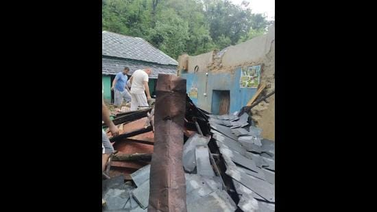 Damage caused to houses due to the widespread rain in Kangra district on Monday. (HT Photo)