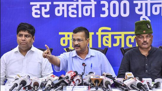 Delhi chief minister Arvind Kejriwal along with Uttarakhand AAP in-charge Dinesh Mohaniya (left) and Colonel Ajay Kothiyal (right) during a press conference in Dehradun on July 11. (PTI)