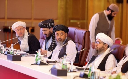 Members of the Taliban delegation look on during the presentation of the final declaration of the peace talks between the Afghan government and the Taliban in Qatar's capital Doha. (AFP)