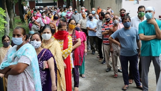 Dr NK Arora of the INSACOG said that the Covid-19 vaccines that are currently used are effective against the Delta variant. In picture - People waiting to receive Covid-19 vaccine.(PTI)