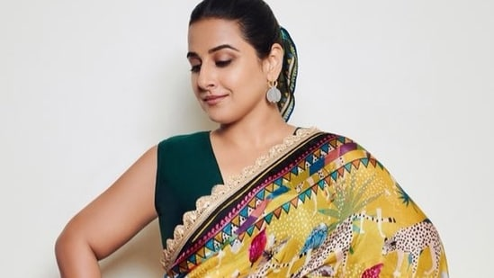 In the pictures, Vidya is seen effortlessly carrying the beautiful printed saree with a light lace embodied on it. To complete the look, she accessorised her outfit with gold and diamond earrings and a large ring and opted for minimal make-up so as to not take away from the sari.(Instagram)