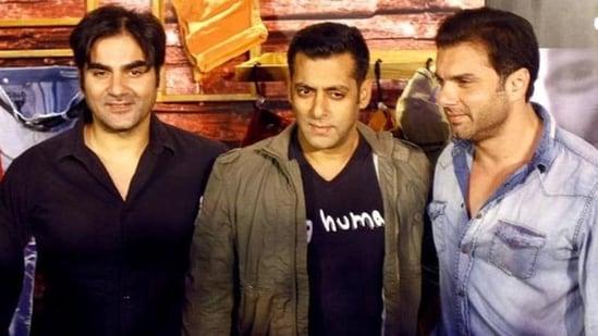 Arbaaz Khan poses with Salman Khan and Sohail Khan.