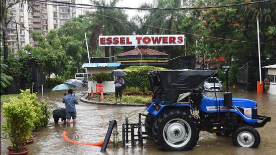 A motor pump was installed at Essel Towers to drain out the rainwater. (Vipin Kumar/HT PHOTO)