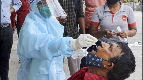 A health worker collects swab samples for Covid-19 tests in Nagpur, Maharashtra. (PTI)