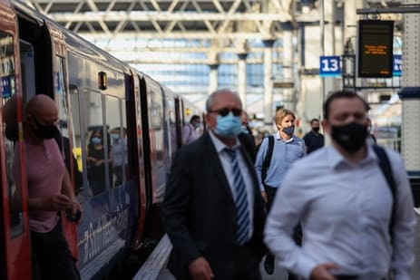 The Spanish government lifted the mandate to wear masks outdoors from June 26 onwards, however, individuals still have to wear them on public transportation, including trains. (Hollie Adams/Bloomberg)