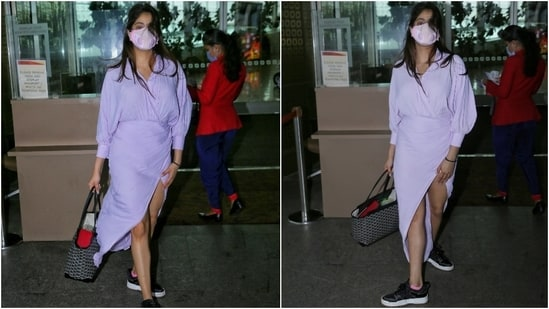 Janhvi wore a breezy full-sleeve dress to catch a flight from the Mumbai airport. Her collared dress featured billowy sleeves with gathered cuffs and an overlapping V-neckline.(Varinder Chawla)