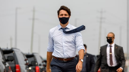 Canada's Prime Minister Justin Trudeau arrives to a press conference at a housing construction site in Brampton, Ontario, Canada.(REUTERS)