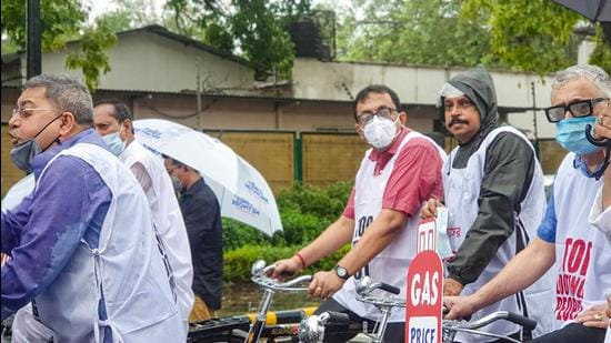 TMC MPs cycle to Parliament to protest against hike in fuel prices, in New Delhi on Monday, July 19. (File photo)