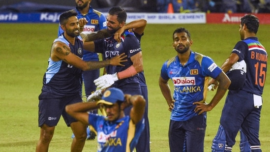 India's Deepak Chahar (C) celebrates with his teammates after India defeated Sri Lanka by 3 wickets in their second one-day international (ODI) cricket match between Sri Lanka and India at the R.Premadasa Stadium in Colombo.(AFP)