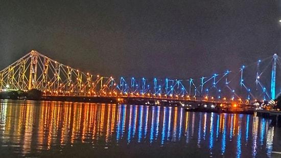 Tokyo Olympics: Kolkata's iconic Howrah Bridge illuminated to boost the morale of Indian athletes.(TWITTER/ANI)