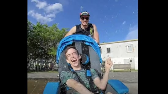 The image shows Brad and Dan enjoying among the water fountains.(Reddit)