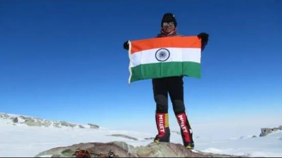 Arunima Sinha standing on top of Mt. Everest.