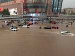 Vehicles are stranded after a heavy downpour in Zhengzhou city, central China's Henan province on Tuesday, July 20, 2021. (AP)