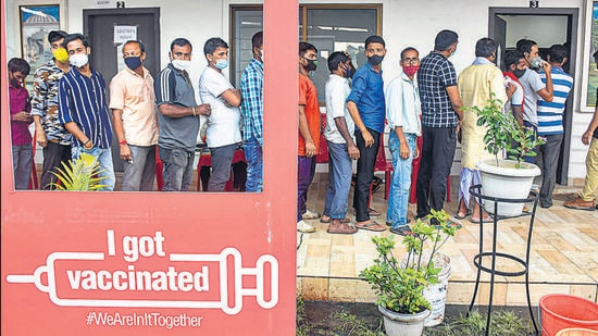 Beneficiaries wait in a queue for their Covid-19 vaccine dose at a centre in Guwahati earlier this month. (File photo)