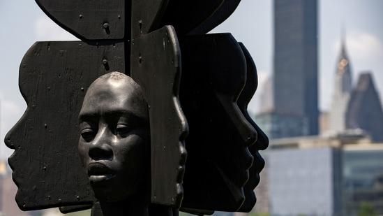 "A sculpture by artist Tanda Francis called ""Rockit Black"" is seen in Queensbridge Park, Queens borough of New York, U.S., July 16, 2021. (REUTERS/Jeenah Moon)"