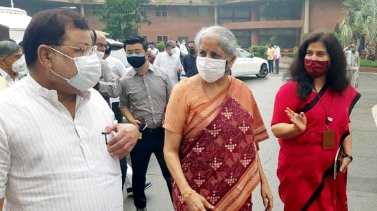 Union Finance Minister Nirmala Sitharaman with others arrives to attend the all BJP MP party meeting at Parliament, in New Delhi on Tuesday. (ANI Photo)