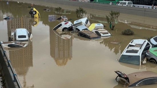 Cars sit in floodwaters after heavy rains hit the city of Zhengzhou in China's central Henan province.(AFP)