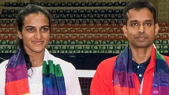 Tokyo Olympics bound badmiton player PV Sindhu and coach P Gopichand at the Gachibowli Stadium in Hyderabad, (PTI)
