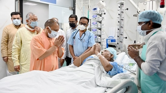 UP Chief Minister Yogi Adityanath visits former chief minister Kalyan Singh at SGPGI in Lucknow. (PTI)