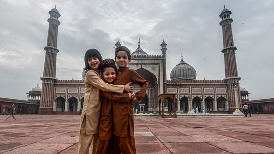 Muslim children greet each other on the occasion of Eid al-Adha at the Jama Masjid, wearing an almost deserted look due to Covid-19 pandemic, in New Delhi, Wednesday, July 21, 2021. (PTI)