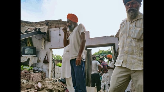 Villagers at the house where the roof came crashing down at Dhudhan Sandha village in Patiala. (PTI)