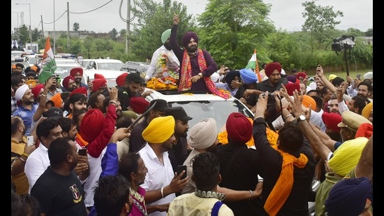 Newly appointed Punjab Congress president Navjot Singh Sidhu during a roadshow in Amritsar on Tuesday.