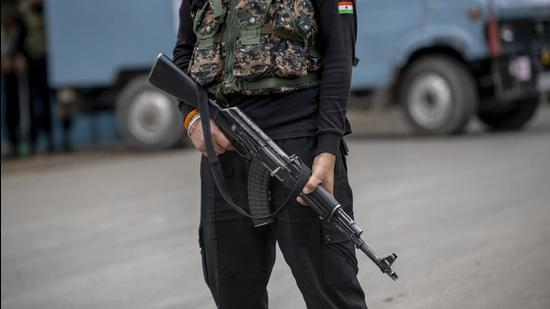 An Indian paramilitary soldier stands guard in on road in Kashmir. (AP)