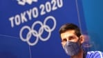Tokyo Olympics: Novak Djokovic of Serbia wears a protective face mask during the press conference