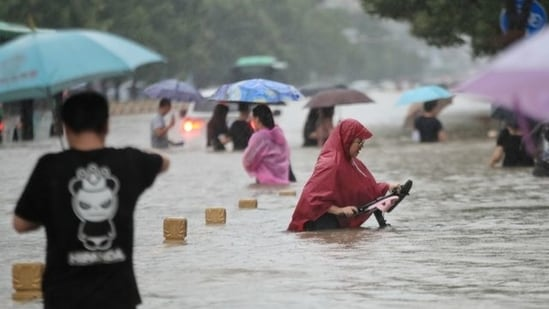 China has also been hit by heavy rains and flooding that resulted in at least 25 deaths in the province of Henan.(Via Reuters)