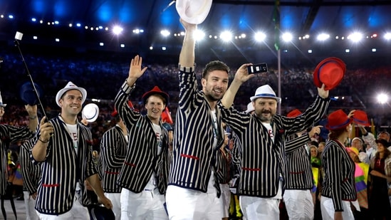 """FILE - Team Czech Republic arrives during the opening ceremony for the Summer Olympics in Rio de Janeiro, Brazil on Aug. 5, 2016. Olympic gear makes for lively social media fodder, starting with the hours-long Parade of Nations. The year's wait due to the pandemic has given enthusiasts extra time to ponder what they love or hate. There's the Czech Republic and its """"Beetlejuice"""" stripes in Rio 2016. (AP)"""