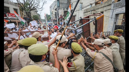 Police trying to stop Congress workers who were trying to gherao the governer's house over fuel price hike in Jammu on Thursday. (PTI)