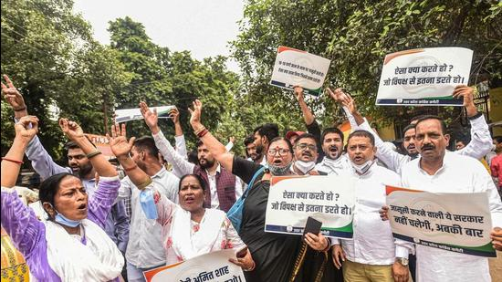 Congress workers staging a protest in Lucknow on Thursday. (PTI PHOTO)
