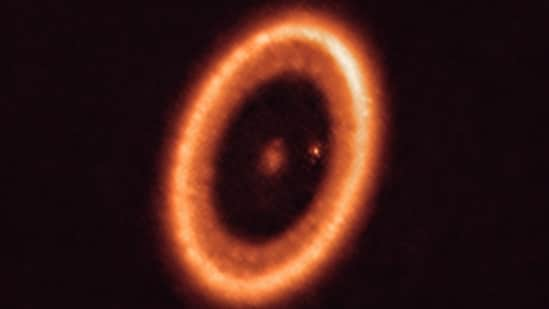 This image shows the PDS 70 system, located nearly 400 light-years away and still in the process of being formed.(Photo by Handout / European Southern Observatory / AFP)