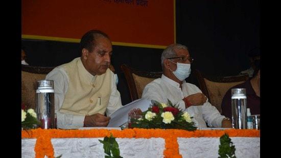 Himachal chief minister Jai Ram Thakur and governor Rajendra Vishwanath Arlekar at the Foundation Day of Himachal Pradesh University in Shimla on Thursday. (Deepak Sansta/HT)
