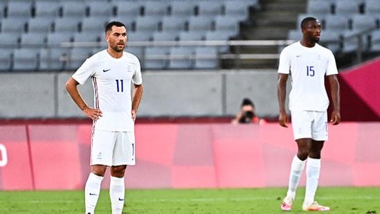 Teji Savanier (L) and Modibo Sagnan of France look on. (Getty Images)