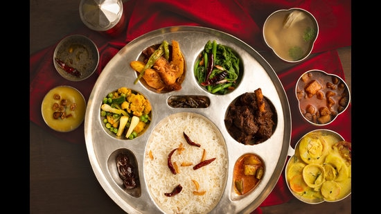 A typical Rana meal, served in silver thaal, includes two types of dal, vegetables, mutton korma, chara ko ras (chicken soup), a yogurt-based salad, pickles and rice.
