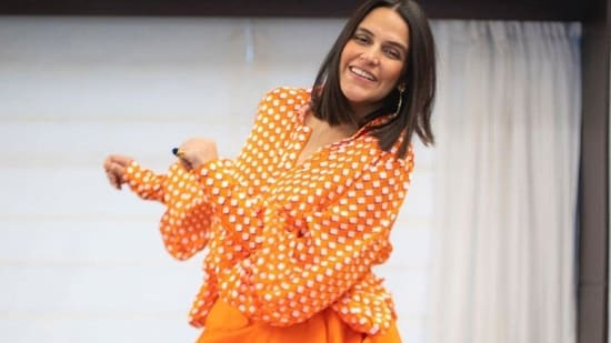 Neha was earlier spotted in the Victorian shirt dress by the brand Made by Cuin, and she paired the multipurpose style style ensemble as a shirt, pairing it with an orange coloured skirt.(Instagram)
