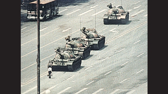 Iconic image. A lone demonstrator blocks the path of a tank convoy along the Avenue of Eternal Peace near Tiananmen Square in June 1989. (Getty Images)