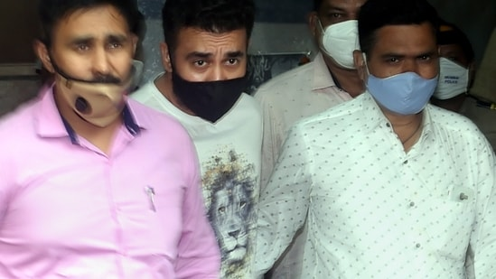 Raj Kundra (Centre) being taken to the Esplanade Court on Friday where his police custody was extended until July 27. (PTI)