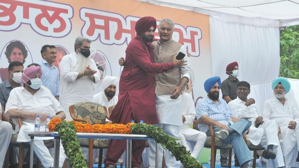 Navjot Singh Sidhu hugging his predecessor, Sunil Jakhar, at the installation ceremony in Chandigarh on Friday. (Ravi Kumar/HT)
