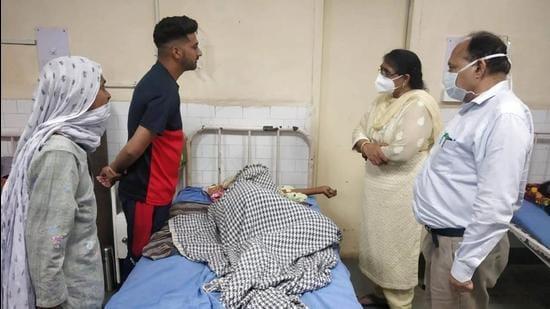 Sangrur civil surgeon Dr Anjana Gupta meets a patient at Bhawanigarh government hospital on Saturday. (HT Photo)