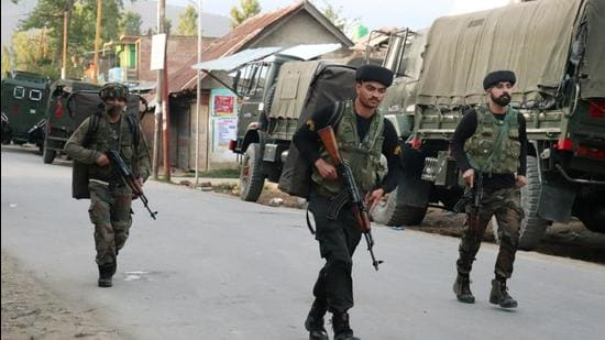 Indian security forces personnel during an encounter with militants in Warpora area of Sopore in north Kashmir's Baramulla district on Friday. (PTI)