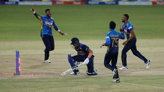 Sri Lankan team members Avishka Fernando, left, Dasun Shanaka, right, Dhananjaya de Silva celebrate the dismissal of India's Manish Pandey during the second one-day international cricket match.(AP)