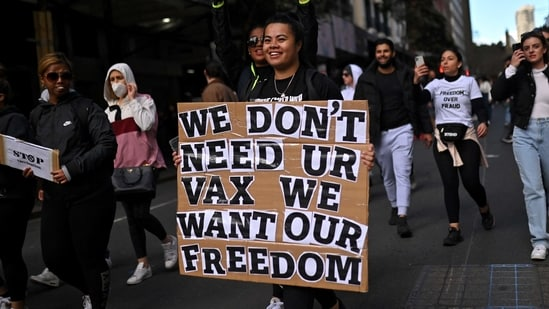 """Most of the anti-lockdown protestors were seen walking maskless and were carrying signboards with slogans like """"Wake up Australia"""" and """"Drain the Swamp"""".. (Photo by Steven SAPHORE / AFP)(AFP)"""